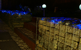 Gabion wall using Reclaimed slab and lighting